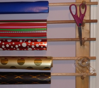 Scissors And Tape Hanging On The Gift Wrap Organizer