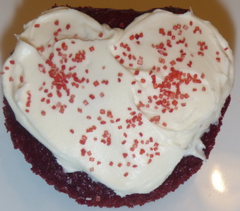 Red Velvet Cupcake with Cream Cheese Frosting and red sprinkles