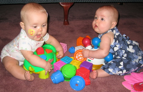 Karlie and Brina having fun with their new toys from the NICU Party-they actually won one of the door prizesc
