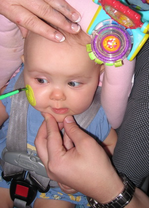 Karlie getting her face painted at the NICU Graduate Partyc