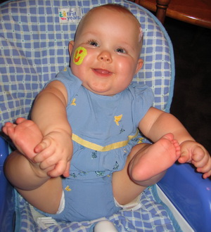 Karlie with her face painted from the NICU Graduate partyc