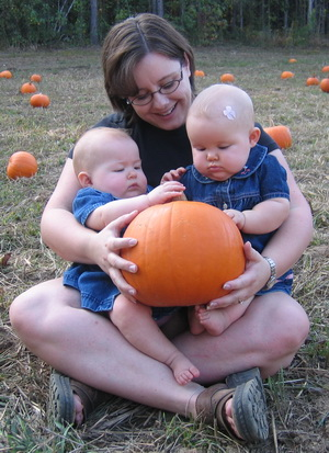 Mommy and the girls checking out their pumpkin - Brina and Karliec